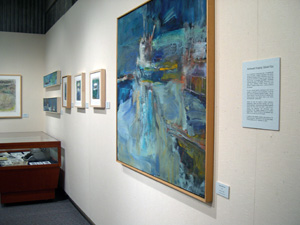 Photo of Edward Epp displaying in the upstairs gallery of Kitimat Museum