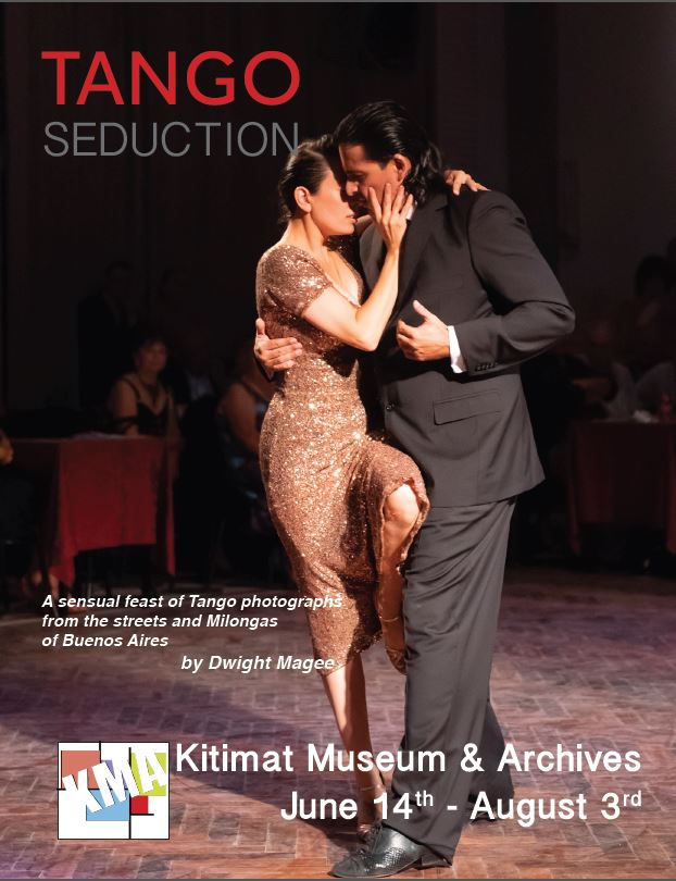 A man and a woman dancing the tango in a dim room